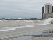 Hurricane Sandy causes the Lake Michigan to rise outside its shore. The Hurricane Sandy in 2012 causes unrest in the Lake Michigan in Chicago royalty free stock photo