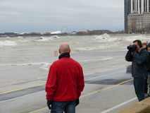 Hurricane Sandy causes the Lake Michigan to rise outside its shore. The Hurricane Sandy in 2012 causes unrest in the Lake Michigan in Chicago stock photos