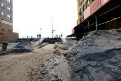 Hurricane Sandy's Aftermath. Dunes of sand cover the streets close by Brighton Beach broadwalk in  Brooklyn, after Hurricane Sandy hit New York area on October Royalty Free Stock Image