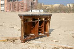 Hurricane Sandy's Aftermath. Part of a bar from a nearby restaurant that was pulled and carried by water, is standing in the middle of Brighton Beach, Brooklyn Stock Image