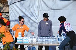 Hurricane Sandy's Aftermath. Leah and Brian, just two of many New York Care organization volunteers,  handing out bottled water to residents of Conney Island Stock Images