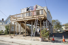 Hurricane Sandy - 1 Year Later Highlands. A house has been raised up and put on stilts in the Highlands, New Jersey.  A sign saying Thank you Volunteers hang on Stock Image