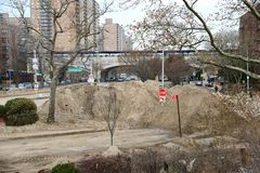 Hurricane Sandys Aftermath. Dunes cover parts of Ocean Parkway close by Brighton Beach broadwalk in  Brooklyn, after Hurricane Sandy hit New York area on October Royalty Free Stock Photos
