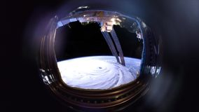 Hurricane, satellite view video through the porthole. Elements of this image furnished by NASA stock footage