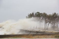 A hurricane at sea. Large waves through a concrete parapet stock image