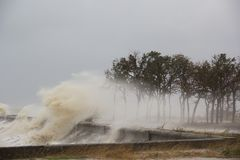 A hurricane at sea. Large waves through a concrete parapet royalty free stock photography