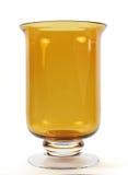 Hurricane Vase. Large amber hurricane case on white Stock Image