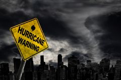 Hurricane Warning Sign Against City Silhouette With Copy Space Stock Images