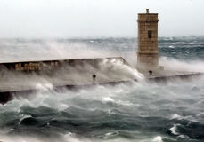 Hurricane wind. On the sea pier, sea dust flying Stock Images