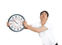 Hurried man holding clock Royalty Free Stock Photos
