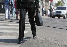 Hurry. Businesswoman's legs as she is walking in a hurry while she is crossing the street Royalty Free Stock Photography