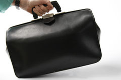 In a hurry. Hand tilts black leather doctor's bag Stock Photo