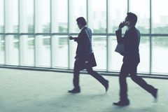 Hurry. Businesspeople in hurry, blurred motion Royalty Free Stock Images