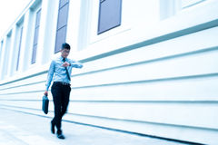 In a hurry. Copy-spaced image of a businessman in a hurry on the foreground Royalty Free Stock Images