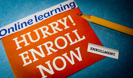 Hurry enroll now. Hurry online learning enroll now with a pencil Royalty Free Stock Photo