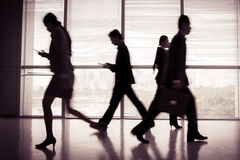 In a hurry. Image of businesspeople in a hurry indoors Royalty Free Stock Image