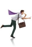 Hurry time. Young businessman running in a hurry Stock Images