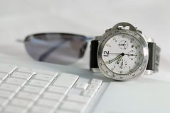 Hurry up. A luxus chronograph on a notebook Royalty Free Stock Image