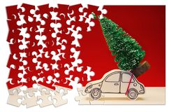 Hurry up! Christmas is coming! Holiday concept with a small pine tree on handmade cartoon toy car in jigsaw puzzle shape.  royalty free stock image