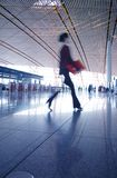 Hurrying in airport Royalty Free Stock Photo