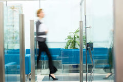Hurrying for briefing. Blurred human figure in motion stock photo