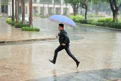 Hurrying Home in Pouring Rain Royalty Free Stock Photography