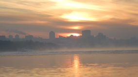Hurrying time of the winter Siberian city. Bathing at mornings in the Siberian frost the megalopolis of Russia Novosibirsk shows new verges of space stock footage
