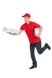 Hurrying to be in time. Cheerful young deliveryman running with Royalty Free Stock Images