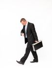 Hurrying to a businessman looking down at his watc Royalty Free Stock Photo