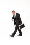 Hurrying to a businessman looking down at his watc Royalty Free Stock Photo