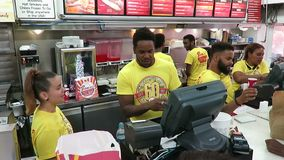 Hurrying to Fill Orders at Ben`s Chili Bowl stock video footage