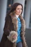 Hurrying woman in fur coat Stock Photo