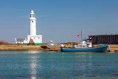 Hurst Point Lighthouse England. Quay at Hurst Spit with the 1867 Hurst Point Lighthouse near Milford-on-sea Hampshire England UK Europe royalty free stock photo