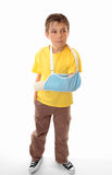 Hurt boy in arm sling Stock Image