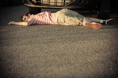 Hurt child in front of car on street Royalty Free Stock Photo