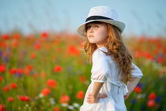 Hurt look young model in hat. Portrait adorable kid girl outdoor Royalty Free Stock Image