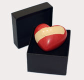 Hurt Love. A heart in a gift box with a plaster on Royalty Free Stock Image