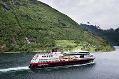 Hurtigruten coastal vessel TROLLFJORD in the Geirangerfjord, Norway Royalty Free Stock Photography
