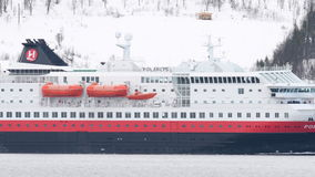 The Hurtigruten cruise ship `Polarys` sailing in a Fjord near the city of Tromsø in Northern Norway stock footage
