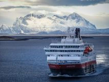 Hurtigruten ship nordnorge cruising in winter landscape royalty free stock photography