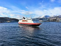 The Hurtigruten ship MS Nordlys entering Harstad harbour. Royalty Free Stock Photography