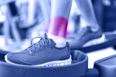 Hurting ankles - pain caused by fitness injury Royalty Free Stock Images