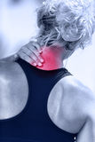 Hurting neck - female runner showing pain with red Royalty Free Stock Images