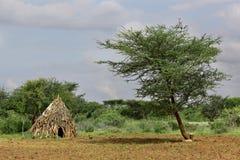 Hus av folk från en stam Hamer Royaltyfri Foto