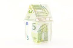 Hus av pengar Arkivfoto