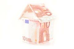 Hus av pengar Arkivbilder
