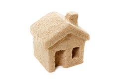 Hus av sand symbol royaltyfria bilder