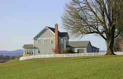 hus för landsgodslantgård Arkivfoton