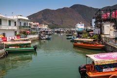 Hus för stylta för Tai-nolla-fiskeläge i Hong Kong Arkivbilder