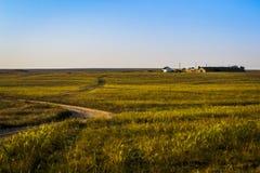 Hus i öknen, vägen till den Arkivfoto